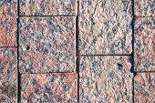 paving slabs of pink granite