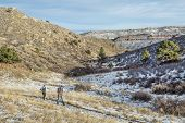 FORT COLLINS, CO, USA - January 6, 2015:  A young couple hiking in Horsetooth Mountain Park, a popular recreation area near Fort Collins in northern Colorado