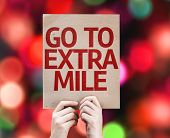 Go To Extra Mile card with colorful background with defocused lights