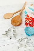 Kitchen molds for baking on color wooden background