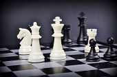 Black and white pieces on a chess board