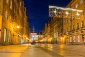 GDANSK, POLAND - DECEMBER 17, 2014: Golden Gate to the old town of Gdansk at night, Poland. Baroque architecture of Gdansk is one of the most notable tourist attractions of the city.