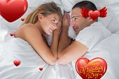 Cute couple lying and looking at each other in bed against happy valentines day