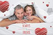 Cheerful couple under the duvet against always and forever