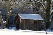 Landscape With Wooden Shack In The Snow