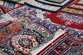 Many Colourful Oriental Carpets For Sale In The Shop Of Rugs