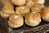 image of cream puff  - Looking at a glass plate filled with delicious decadent cream puffs - JPG