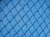 Blue mesh construction fence