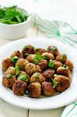 image of meatball  - meatballs grilled with parsley on a white wood background - JPG