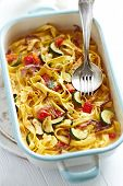 Tagliatelle baked with vegetables and parmesan