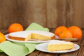 Cut Clementine Pie With Clementines On Wooden Background