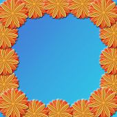 Frame From Brown Flowers On Blue Background