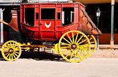 image of stagecoach  - A old red stage coach with yellow wheels - JPG