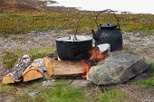 Постер, плакат: Outdoor cooking on campfire