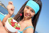 healthy woman eating fruit