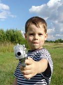 Little boy with toy pistol poster