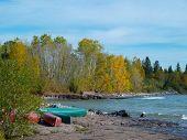 Canoes On Rocky Beach