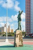 Statue of Jose Marti carrying a child facing the US Interests Section in Havana