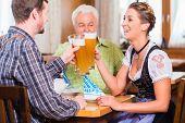 People drinking wheat beer in bavarian restaurant