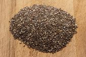 Heap of chia seeds on wood