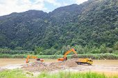 foto of monster-truck  - Monster machines working on site at Thailand - JPG