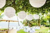 stock photo of ceremonial clothing  - Many lamp setup for wedding ceremony on beach - JPG