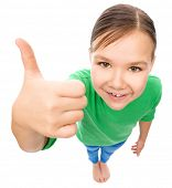 Little girl is showing thumb up gesture, fisheye portrait, isolated over white
