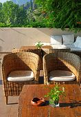 Greece. Corfu. An Open-air Cafe With Table And Chairs