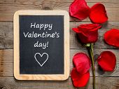 Red Rose And Happy Valentines Day! Text On Blackboard