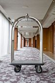 Hotel Luxury Trolley Barrow Silver Chrome Parked At Walkway In Hotel.