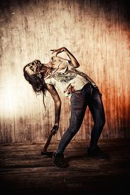 foto of doomsday  - Scary bloody zombie girl with an ax - JPG