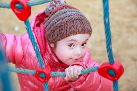 foto of playgroup  - Portrait of beautiful girl on the playground - JPG