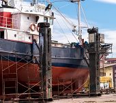 stock photo of shipyard  - Prow and starboard detail of a fishing boat in a shipyard for maintenance - JPG