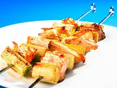 picture of leek  - Salmon skewers with leek on a white plate - JPG