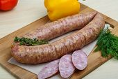 stock photo of raw chicken sausage  - Smoked sausages with dill on the wood background - JPG