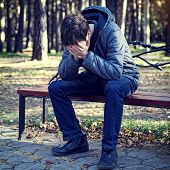 foto of sad  - Toned Photo of Sad Young Man in the Autumn Park - JPG