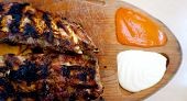 picture of spare  - spare ribs in wooden tray with sauce - JPG