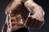 pic of blood vessels  - Handsome muscular bodybuilder shows his fist and vein blood vessels - JPG