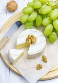picture of brie cheese  - Soft brie cheese with sweet grapes and nuts - JPG