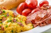 picture of scrambled eggs  - Scrambled eggs with bacon chive and tomatoes fresh juice and little microgreens healthy salad - JPG