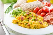 pic of scrambled eggs  - Scrambled eggs with bacon chive and tomatoes fresh juice and little microgreens healthy salad - JPG