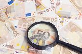 image of fifties  - Closeup of fifty euro notes through magnifer background - JPG
