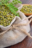 stock photo of chickpea  - Chickpea varieties in a burlap bag on a wooden background - JPG