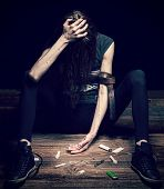 pic of drug addict  - Grunge cross vintage filtered photo of a woman posing as drug addict concept photo - JPG