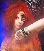 stock photo of woman dragon  - Smoke and young ginger woman with artistic visage - JPG