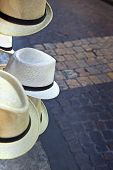 picture of stall  - Straw hats on a market stall in town - JPG
