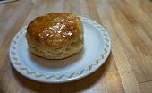 pic of maple syrup  - fresh baked biscuit with maple syrup on top - JPG
