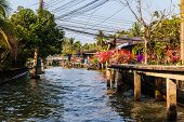 stock photo of street-rod  - hovels of a small village on the riverside of a canal in the thai countryside in Ratchaburi district Thailand - JPG