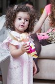image of baby doll  - Baby girl plays with a doll her parents find out the relationship in the background - JPG