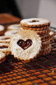 picture of linzer  - pile of linzer cookies heart shaped with marmelade - JPG